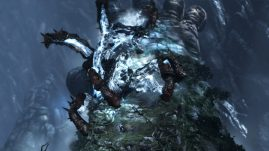 gow3-kratos-climbing-on-gaias-arm